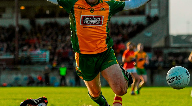 Castlebar's Richie Feeney is fouled by Alan Burke of Corofin during yesterday's Connacht SFC club final