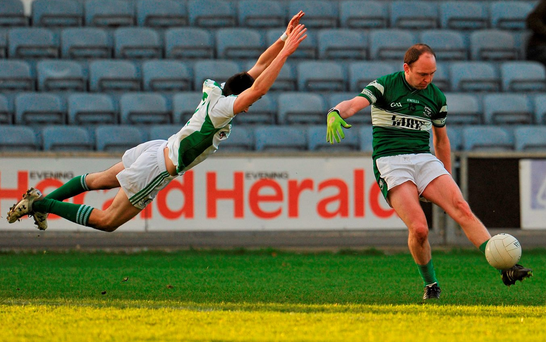 Killoe's Liam Hughes blocks an attempt at goal from Brian McCormack of Portlaoise