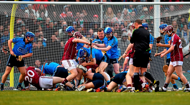 Players from Dublin and Galway tussle during the AIG Fenway Hurling Classic at Fenway Park yesterday