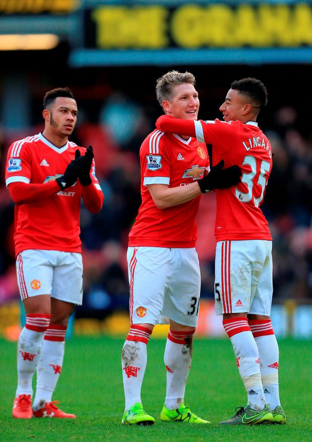 Jesse Lingard and Bastian Schweinsteiger celebrate United's win over Watford