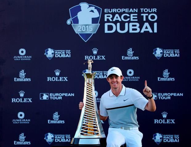 Rory McIlroy poses with the Race to Dubai trophy after he won the final round of the DP World Tour Championship golf tournament