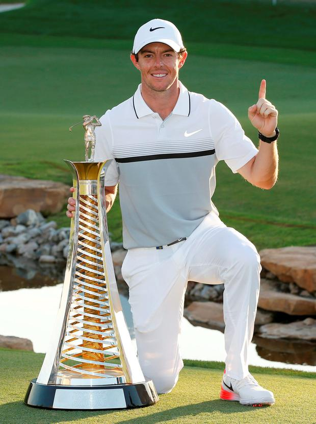 The message is clear as Rory McIlroy poses with the trophy in Dubai