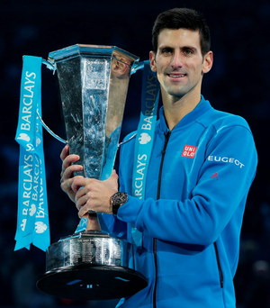 Novak Djokovic celebrates with the trophy