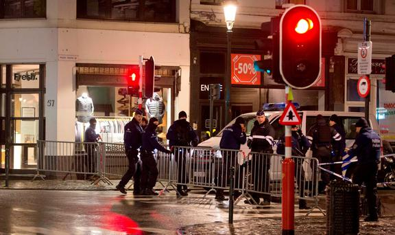 Police set up a barricade during an operation in the center of Brussels on Sunday