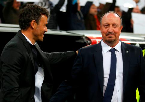 Barcelonas head coach Luis Enrique, left, and Real Madrid's headcoach Rafael Benitez, shake hands during the first clasico of the season between Real Madrid and Barcelona at the Santiago Bernabeu stadium in Madrid, Spain, Saturday, Nov. 21, 2015. (AP Photo/Francisco Seco)