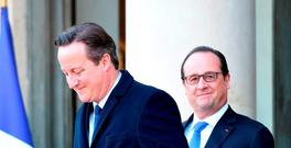 French President Francois Hollande (R) escorts British Prime Minister David Cameron