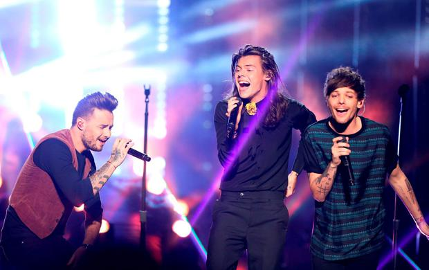 Liam Payne, from left, Harry Styles, and Louis Tomlinson of One Direction perform at the American Music Awards at the Microsoft Theater on Sunday, Nov. 22, 2015, in Los Angeles. (Photo by Matt Sayles/Invision/AP)
