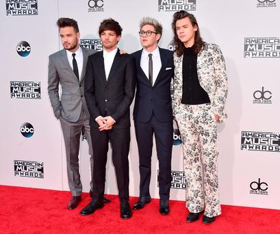 Liam Payne, from left, Louis Tomlinson, Niall Horan, and Harry Styles of One Direction arrive at the American Music Awards at the Microsoft Theater on Sunday, Nov. 22, 2015, in Los Angeles