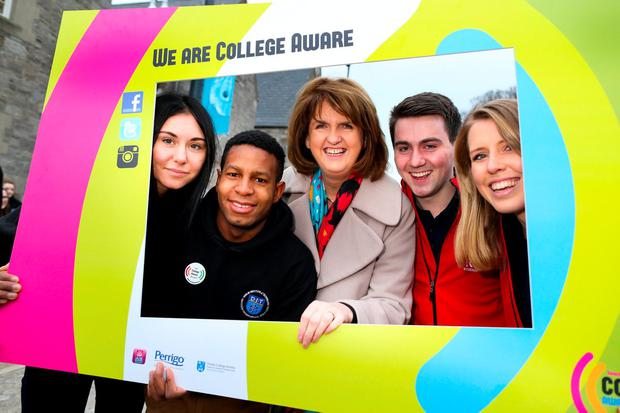 Tanaiste Joan Burton launches College Awareness Week 2016 with students (l to r) Claudia Hergh, Pierre Yimbug, Paul Fox and Beth Wolfe at DIT Grangegorman, Dublin