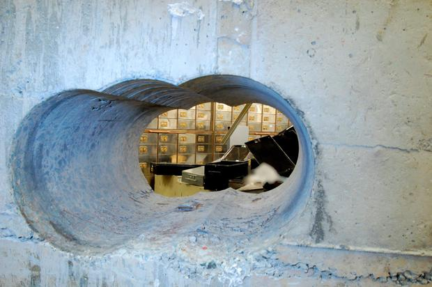 Raiders used a drill to bore a hole 51cm deep, 25cm high and 46cm into the wall of a vault in London's jewellery quarter, before ransacking 73 safety deposit boxes. Photo: AFP/Getty Images