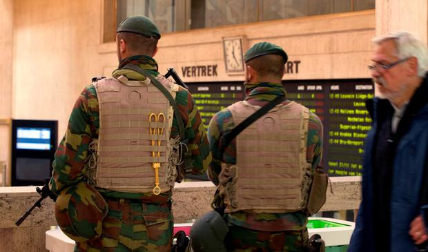 Belgian Army soldiers patrol in the central train station in Brussels on Monday