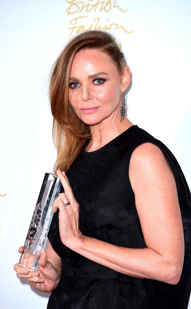 Stella McCartney wins the Brand Award at the British Fashion Awards at the London Coliseum, St Martin's Lane, in London. PRESS ASSOCIATION Photo. Picture date: Monday November 23, 2015: Ian West/PA Wire