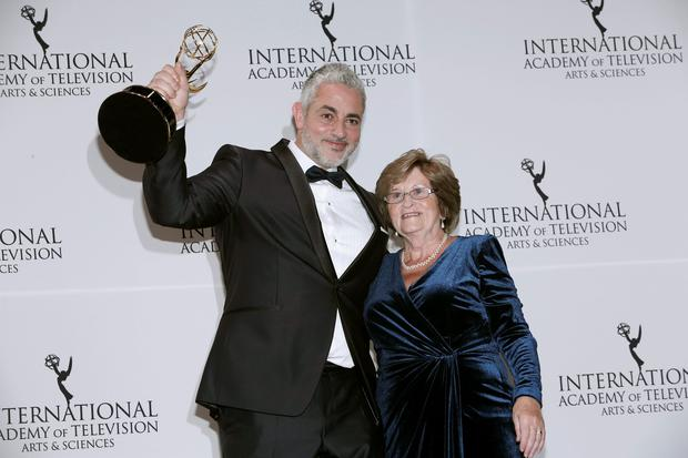 (L-R) Producer Baz Ashmawy and his mother Nancy Ashmawy pose with the International Emmy award in the 'Non-Scripted Entertainment' category for '50 Ways to Kill Your Mammy' during the 43rd International Emmy Awards Gala in Manhattan, New York November 23, 2015. REUTERS/Andrew Kelly