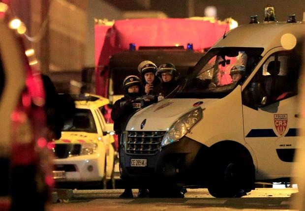 Police take up position near the scene of a shootout in Roubaix, northern France REUTERS/Pascal Rossignol