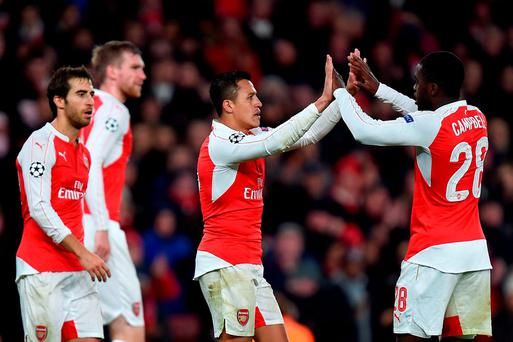 Arsenal's Alexis Sanchez (centre) celebrates scoring his sides third goal of the game with team-mate Joel Campbell (right) during the UEFA Champions League, Group F match at The Emirates Stadium, London. PRESS ASSOCIATION Photo. Picture date: Tuesday November 24, 2015. See PA story SOCCER Arsenal. Photo credit should read: Andrew Matthews/PA Wire.
