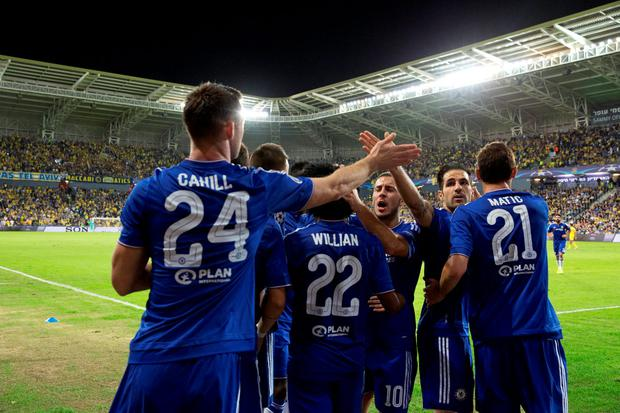 Chelseas Gary Cahill, left, celebrates his opening goal against Maccabi Tel Aviv during group G Champions League soccer match in Haifa, Israel, Tuesday, Nov. 24, 2015. (AP Photo/Ariel Schalit)