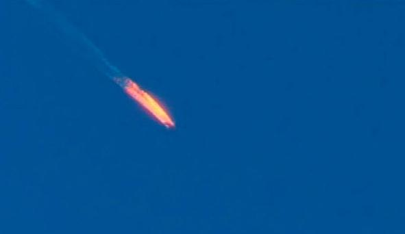 The Russian jet explodes in a fireball after being shot down over Syria