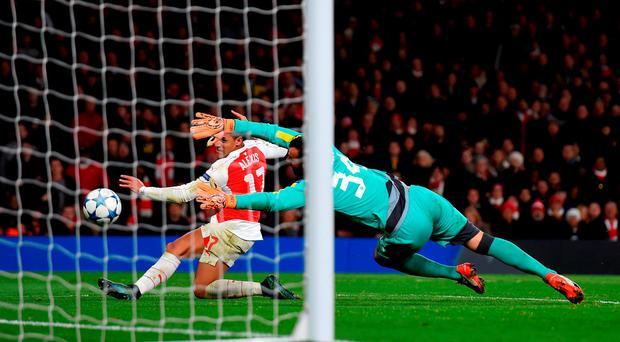 Alexis Sanchez fires the ball past Eduardo to score Arsenal's third goal