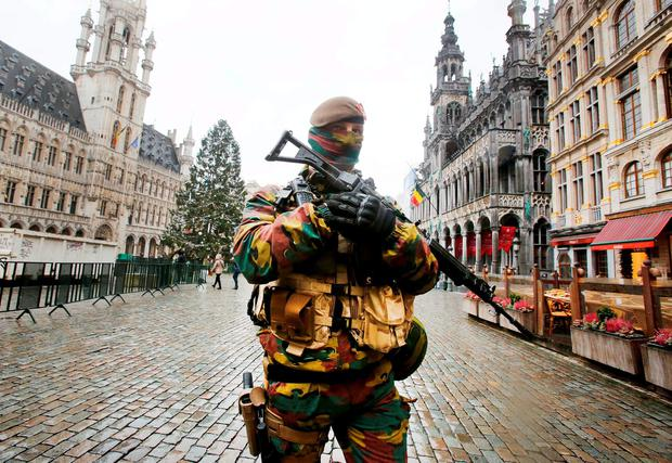 A Belgian police officer patrols the Grand Place in central Brussels yesterday. Photo: AP