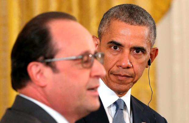 US President Barack Obama listens intently to French President Francois Hollande during a joint news conference in the East Room of the White House yesterday