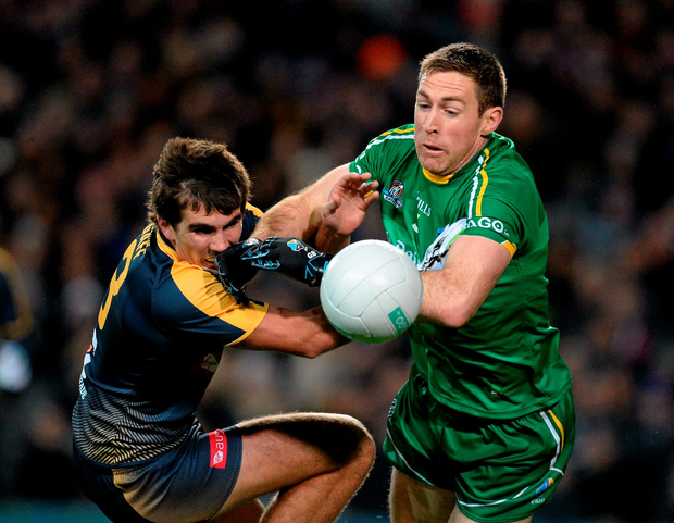 Clare star Gary Brennan gets the better of Australia's Andrew Gaff (left) during Saturday's International Rules clash