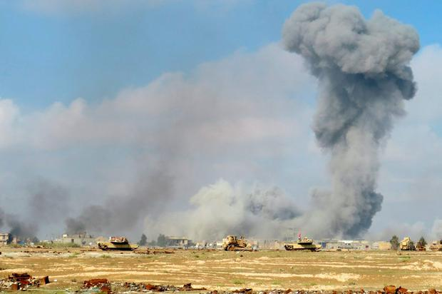 Smoke rises from Islamic State positions following a U.S.-led coalition airstrike while Iraq anti-terrorism forces advance their position during clashes with Islamic State group in the western suburbs of Ramadi, the capital of Iraq's Anbar province, 70 miles (115 kilometers) west of Baghdad, Iraq. (AP Photo/Osama Sami)