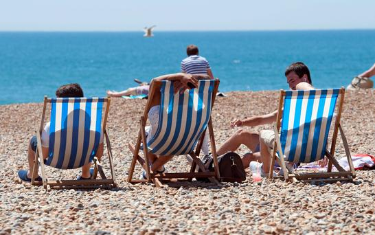 File photo dated 30/06/15 of sunbathers enjoying the warm weather on the beach in Brighton, East Sussex, as this year is very likely to be the hottest year on record worldwide, the World Meteorological Organisation has said. Photo: Lauren Hurley/PA Wire