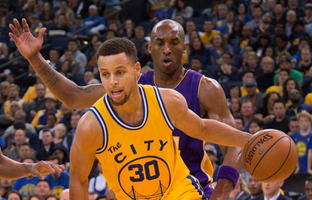 Golden State Warriors guard Stephen Curry (30) dribbles the basketball against Los Angeles Lakers forward Kobe Bryant (24) Mandatory Credit: Kyle Terada-USA TODAY Sports
