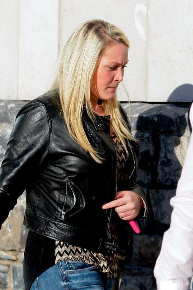 Lynsey Ivory (27) of The Beeches, Clonshaugh, Priorswood, Dublin, leaving court where she pleaded guilty to attempting to dishonestly by deception cause a loss to FBD Insurance on dates between July, 2013 and January, 2014. Pic: Courtpix