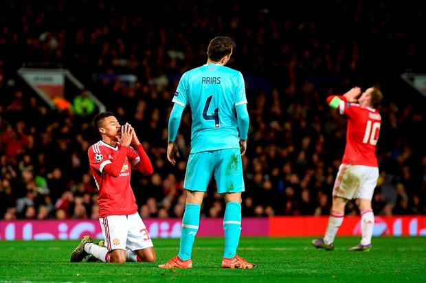 Manchester United's Jesse Lingard and Wayne Rooney rue a missed chance on goal during the 0-0 draw with PSV Eindhoven.