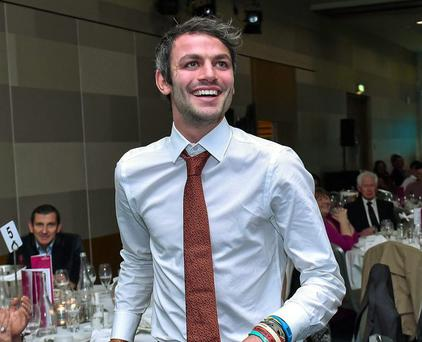 Thomas Barr lifts his Athlete of the Year during the GloHealth National Athletic Awards 2015
