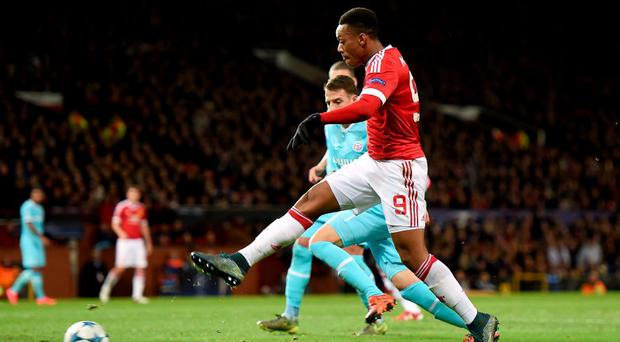 Anthony Martial with an effort on goal against PSV.