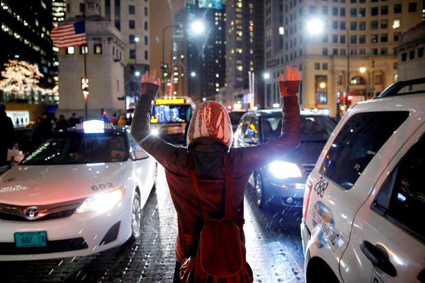 A protester demonstrates in response to the fatal shooting of Laquan McDonald in Chicago, Illinois, November 25, 2015