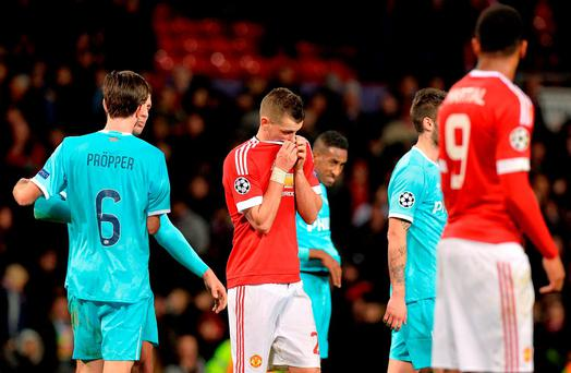 Manchester United's Morgan Schneiderlin (centre) appears dejected after the final whistle during the UEFA Champions League game at Old Trafford