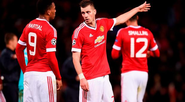 Morgan Schneiderlin and Anthony Martial of Manchester United in discussion after the UEFA Champions League Group B match between Manchester United FC and PSV Eindhoven