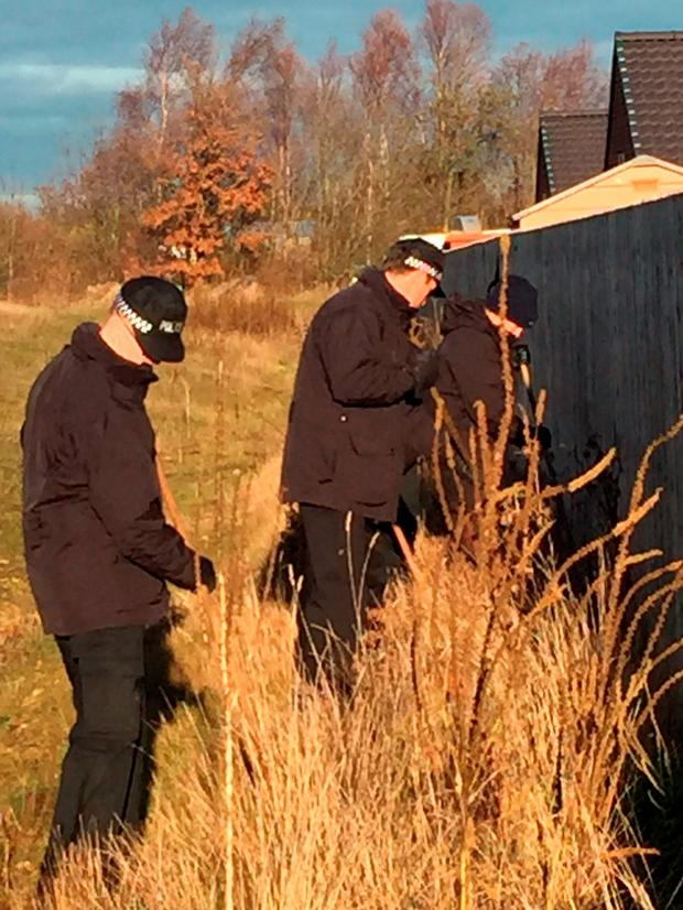 Durham Police officers carry out searches of open land in West Rainton, County Durham, as part of an operation across northern England aimed at stopping an escalating feud in the travelling community which saw two teenagers' skulls being dug up and stolen from a grave