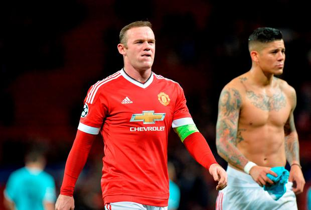 Manchester United's Wayne Rooney and Marcos Rojo (right) after the final whistle against PSV