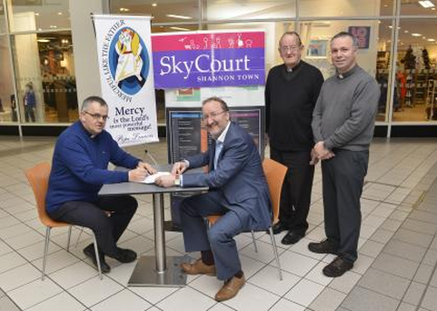 Fr Tom PP Shannon with Skycourt Manager Pat Kelly, Canon Brendan O'Donoghue AP and Fr Arnold Rosney CC Shannon pictured in Skycourt Shopping Centre ahead of the 'Mercy on the Mall' initiative to mark the opening of the Year of Mercy on December 8. Photo: The Irish Catholic