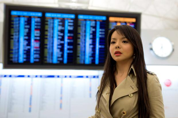 Miss World Canada Anastasia Lin poses for photo at the departure hall of Hong Kong Airport in Hong Kong, China November 26, 2015