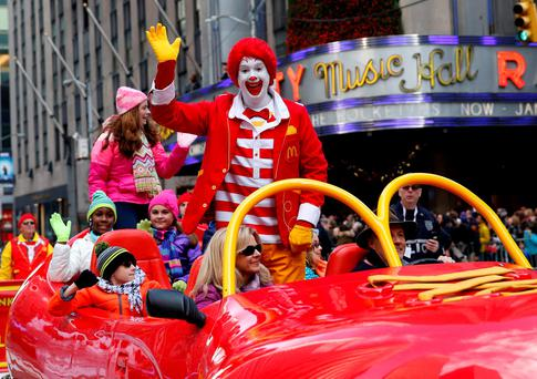 Ronald McDonald waves as he makes his way down 6th avenue during the 89th Macy's Thanksgiving Day Parade in the Manhattan borough of New York, November 26, 2015. REUTERS/Shannon Stapleton