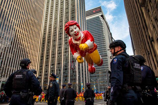 The Ronald McDonald balloon makes its way across Sixth Avenue as heavily armed police stand guard during the Macy's Thanksgiving Day Parade, Thursday, Nov. 26, 2015. (AP Photo/Andres Kudacki)