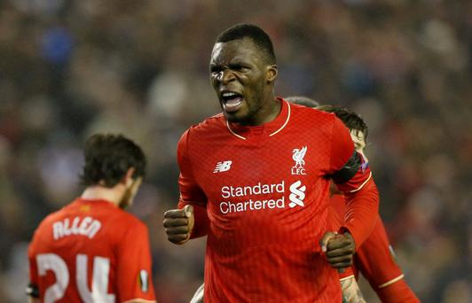 Christian Benteke celebrates after scoring the second goal for Liverpool