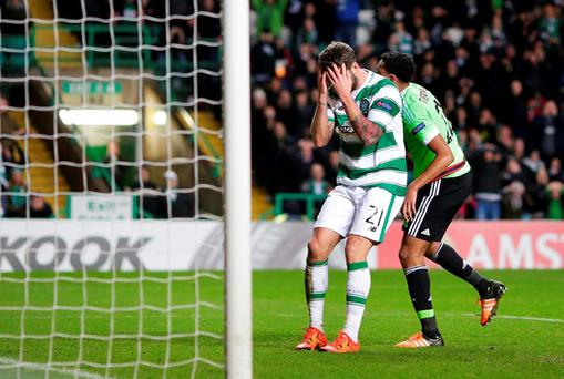Celtic's Charlie Mulgrew looks dejected after missing a chance to score