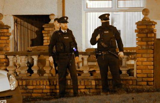 Armed Police at the scene of a shooting that was carried out by a gun man on a police car incident in the Rosnareen Area of west Belfast, Northern Ireland on November 26 (Photo by Kevin Scott / Presseye )
