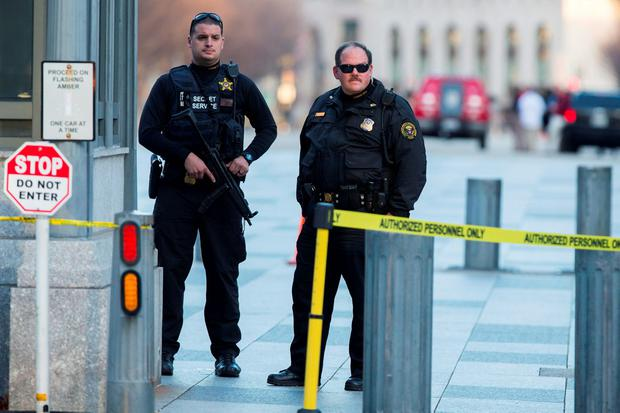 Secret Service police stand guard outside the White House after a man was caught jumping the fence as President Barack Obama and his family ate Thanksgiving dinner (AP Photo/Evan Vucci)