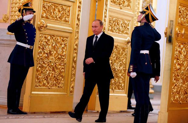 Russia's President Vladimir Putin (centre) arrives at a ceremony for foreign ambassadors at the Kremlin
