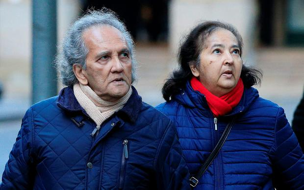 Maoist Aravindan Balakrishnan arrives with an unidentified woman at Southwark Crown Court, London, where he denies seven counts of indecent assault and four counts of rape against two women during the 1970s and 1980s