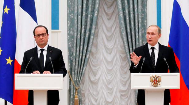 Russia's President Vladimir Putin (R) and his French counterpart Francois Hollande attend a news conference after a meeting at the Kremlin in Moscow Credit: Alexander Zemlianichenko (REUTERS)