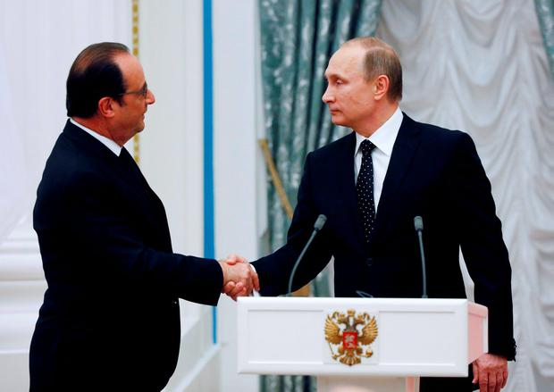 Russia's President Vladimir Putin shakes hands with French President Francois Hollande Credit: Sergei Chirikov (REUTERS)