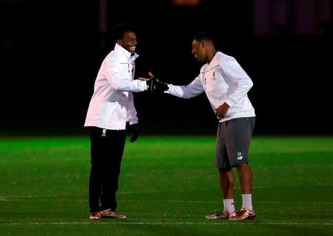 Daniel Sturridge and Jordon Ibe of Liverpool greet each other during a training session at Melwood Training Complex